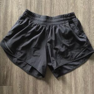 Black Lululemon Tall shorts.